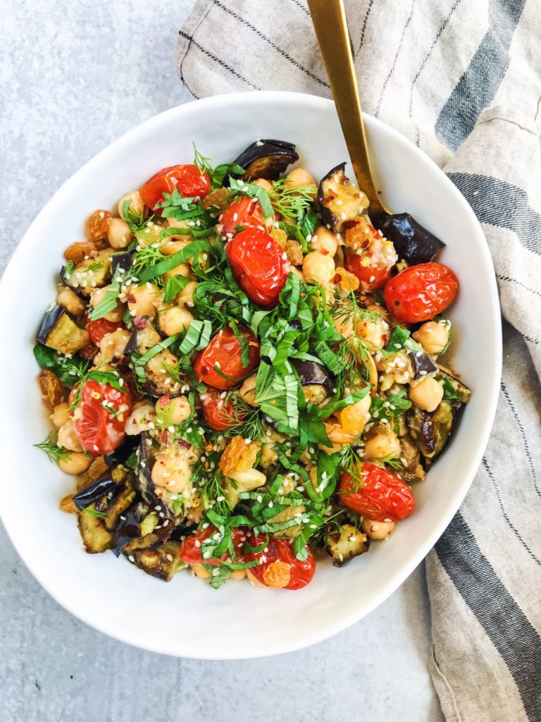 chickpea and roasted vegetable salad with golden raisins and fresh herbs